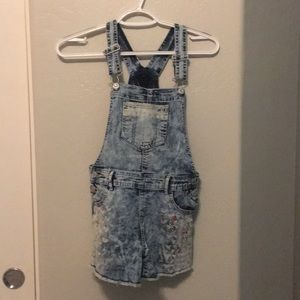 Kids jean jumper with colorful detailing.